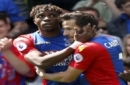 Crystal Palace's Wilfried Zaha, left, celebrates scoring his side's first goal of the game with teammate Yohan Cabaye, during the English Premier League soccer match between Crystal Palace and Hull City, at Selhurst Park, London, Sunday May 14, 20