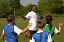 Watch Liverpool star Daniel Sturridge stun primary school pupils with surprise visit