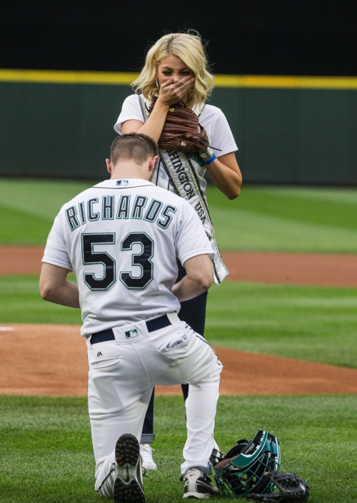 Boyfriend proposes to Miss Washington after he catches her pitch at Mariners game
