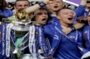 Chelsea captain John Terry, second right, raises the trophy after they won the league, following the English Premier League soccer match between Chelsea and Sunderland at Stamford Bridge stadium in London, Sunday, May 21, 2017. (AP Photo/Frank Augstein)