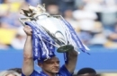 Chelsea's John Terry holds the English Premier trophy at the end of the English Premier League last round soccer match between Chelsea and Sunderland at Stamford Bridge stadium in London, Sunday, May 21, 2017. (AP Photo/Kirsty Wigglesworth)