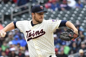 Long ball burns Twins in 1st game of doubleheader