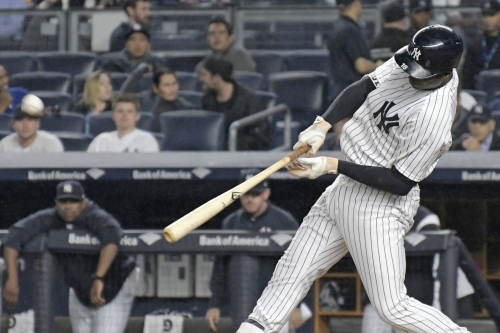 Yankees ride a bunch more homers to slip past Royals