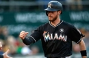 Marlins bang out season-high 19 hits, hold on to beat A's