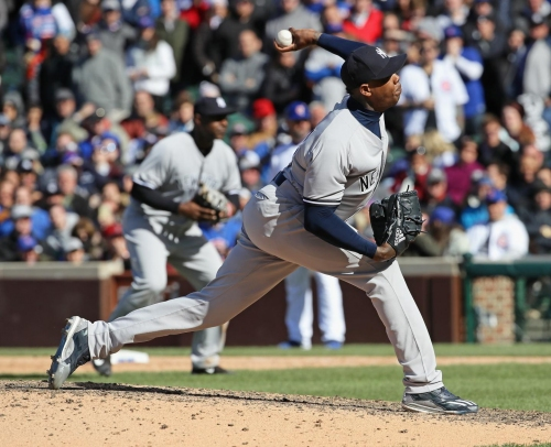 Chapman to see doc Friday, could start throwing program Saturday