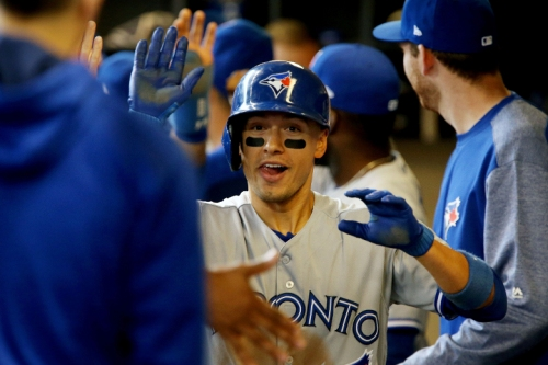 Booming bats power Blue Jays to victory over Brewers
