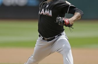 Gray fans 11, Davis homers as A's top Marlins 4-1