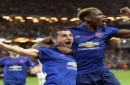 Manchester United's Henrikh Mkhitaryan, left, celebrates scoring with teammate Paul Pogba during the Europa League soccer final match between Ajax and Manchester United at the Friends Arena in Stockholm, Sweden, Wednesday May 24, 2017. (Anders Wiklun