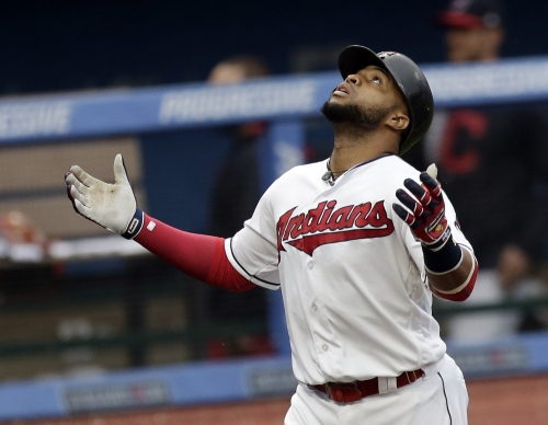 Cleveland Indians' Carlos Santana shines in a game that ended not once, but twice