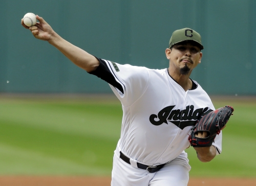 Cleveland Indians use Carlos Carrasco's strong start plus three homers to beat Oakland A, 5-3