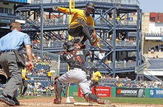 Andrew McCutchen makes valiant effort to avoid tag at home with Olympic-like hurdle