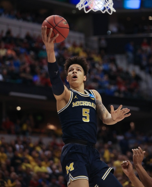 Michigan's D.J. Wilson selected 17 by Milwaukee in the NBA draft