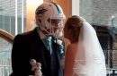 Wife buys husband a Miami Dolphins helmet to wear during their wedding