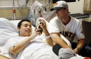 Giants catcher Buster Posey brightens day at pediatric cancer ward