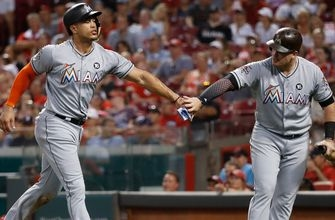 Marlins weather lengthy delay to take opener from Reds