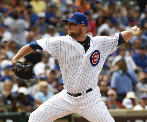 With a heavy heart, Jon Lester strong against Cardinals