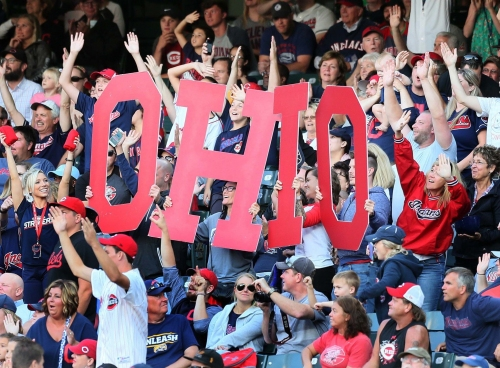 Cleveland Indians' Carlos Santana talks to Manny Ramirez about pressure; hits 2 HRs vs. Reds