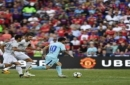 IMAGE DISTRIBUTED FOR INTERNATIONAL CHAMPIONS CUP - Barcelona's Lionel Messi (10) outpaces Manchester United defenders Henrikh Mkhitaryan (22) and Michael Carrick on Wednesday, July 26, 2017, in Landover, Md. (Larry French/AP Images for International