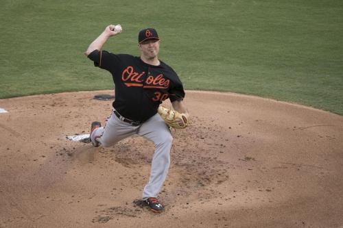 Tillman allows eight earned runs in Orioles 8-2 loss to Rangers