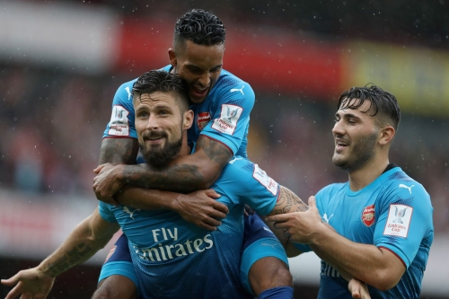 Theo Walcott makes starting case as Arsenal hit five against Benfica