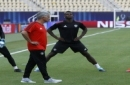 Manchester United's manager Jose Mourinho, front, walks past David de Gea, left, Paul Pogba, center and Romelu Lukaku, right, during a training session at Philip II Arena in Skopje, Macedonia, Monday, Aug. 7, 2017, a day ahead of UEFA Super Cup final