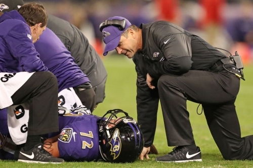 How does the loss of LG Alex Lewis affect the Baltimore Ravens?