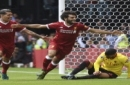Liverpool's Mohamed Salah, center, celebrates scoring his side's third goal during the English Premier League soccer match at Vicarage Road, Watford, England, Saturday, August 12, 2017. (Daniel Hambury/PA via AP)