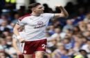 Burnley's Stephen Ward celebrates scoring his side's second goal during the English Premier League soccer match between Chelsea and Burnley at Stamford Bridge stadium in London, Saturday, Aug. 12, 2017. (AP Photo/Kirsty Wigglesworth)
