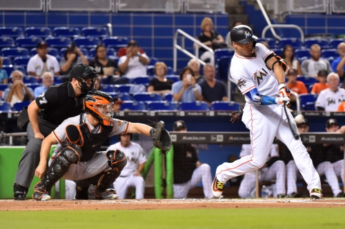 Giancarlo Stanton's power show beats Giants, but could he join them?