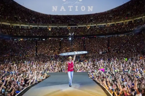Kenny Chesney is wearing a Chiefs shirt at Arrowhead on his new album cover