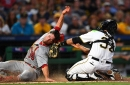 Cardinals survive a meltdown in Pittsburgh