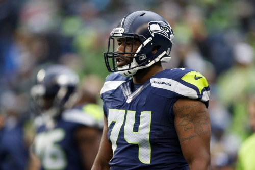 George Fant carted off field after suffering apparent right knee injury
