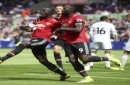 Manchester United's Eric Bailly, left, celebrates with teammate Romelu Lukaku after scoring his side's first goal during their English Premier League soccer match at the Liberty Stadium, Swansea, Wales, Saturday, Aug. 19, 2017. (Nick Potts/PA via