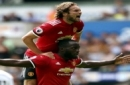 Manchester United's Romelu Lukaku, centre, celebrates scoring his side's second goal with team-mate Daley Blind during the English Premier League soccer match between Swansea and Manchester United, at the Liberty Stadium, in Swansea, Wales, Saturd