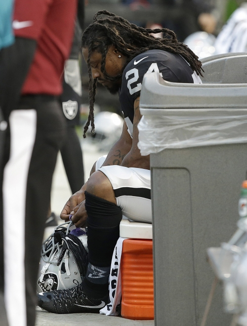 Marshawn Lynch sits once again during national anthem The Associated Press