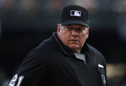 Umpire Hunter Wendelstedt leaves Boston Red Sox vs. Indians game after Joe Kelly's warmup pitch hits him