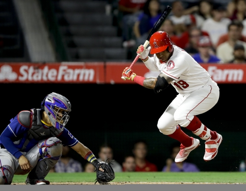 Angels fall out of playoff position with loss to Rangers