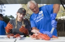 Lobster chefs from San Pedro Fish Market give tips on making delicious lobster at Dana Point Lobster Fest