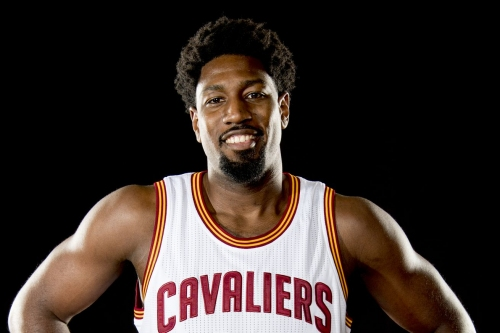 Cavs sign guard John Holland to two-way contract, per report