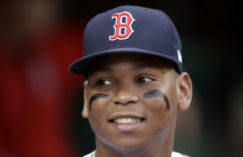 Evan Longoria spoke to Rafael Devers, Boston Red Sox rookie, in Spanish during Friday's game; what did he say?