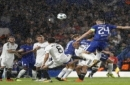 Chelsea's Gary Cahill, top right, jumps for the ball during the Champions League group C soccer match between Chelsea and Qarabag at Stamford Bridge stadium in London, Tuesday, Sept. 12, 2017. (AP Photo/Kirsty Wigglesworth)