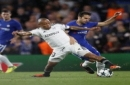 Qarabag's Dino Ndlovu, left, challenges for the ball with Chelsea's Gary Cahill during the Champions League group C soccer match between Chelsea and Qarabag at Stamford Bridge stadium in London, Tuesday, Sept. 12, 2017. (AP Photo/Kirsty Wiggleswor
