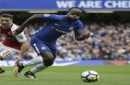 Chelsea's Victor Moses breaks through Arsenal defense with Arsenal's Sead Kolasinac, left, during the English Premier League soccer match between Chelsea and Arsenal at Stamford Bridge stadium in London, Sunday, Sept. 17, 2017. (AP Photo/Tim Irela