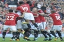 Manchester United players celebrate after Manchester United's Antonio Valencia, hidden, scored his sides first goal during the English Premier League soccer match between Manchester United and Everton at Old Trafford in Manchester, England, Sunday, Se
