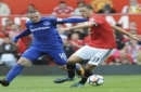 Everton's Wayne Rooney, left, and Manchester United's Nemanja Matic battle for the ball during the English Premier League soccer match between Manchester United and Everton at Old Trafford in Manchester, England, Sunday, Sept. 17, 2017. (AP Photo/