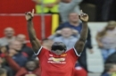 Manchester United's Romelu Lukaku celebrates after scoring his side's third goal during the English Premier League soccer match between Manchester United and Everton at Old Trafford in Manchester, England, Sunday, Sept. 17, 2017. (AP Photo/Rui Vie
