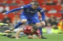 Manchester United's Ander Herrera and Everton's Wayne Rooney clash during the English Premier League soccer match between Manchester United and Everton at Old Trafford in Manchester, England, Sunday, Sept. 17, 2017. (AP Photo/Rui Vieira)
