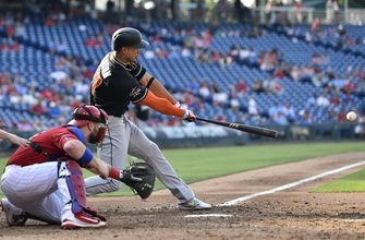 Marlins infielder Miguel Rojas leaves game with apparent arm injury
