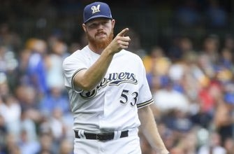 Woodruff strong for 7 innings as Brewers top Marlins