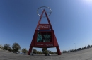 No, the Angels are NOT demanding a 12-foot wall be built outside of Angels Stadium